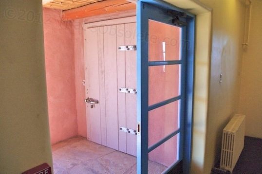 The kitchen entrance (the blue door) is flanked outside by a walk-in freezer installed to service the kitchen.