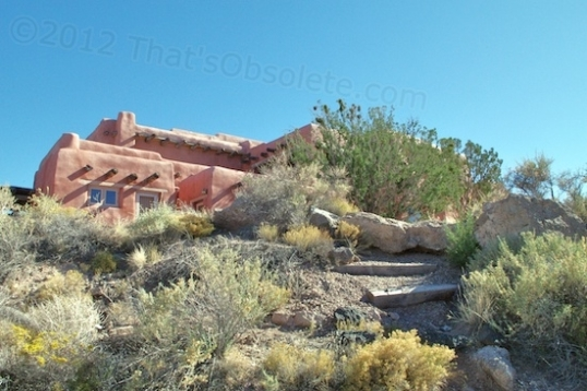 This is the Painted Desert Inn as viewed from a wilderness walking trail that winds below it down to the canyon floor.