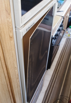 And the refrigerator's decorative panel vibrated out of position. If this helps insolation and so puts the beer in jeopardy, THIS repair will become priority one...