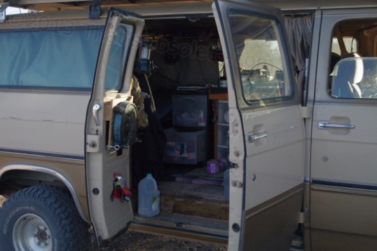 You have to be pretty committed to this style of living in order to be comfortable with it. You're looking into the stubby kitchen area, and the bed spans the back. Makes my 26' travel trailer seem mighty cushy in comparison!