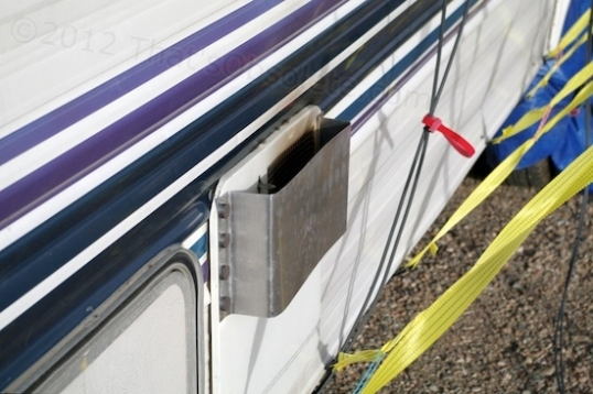 This awesome aluminum shield is intended to allow the water heater to fire up regardless of the weather.