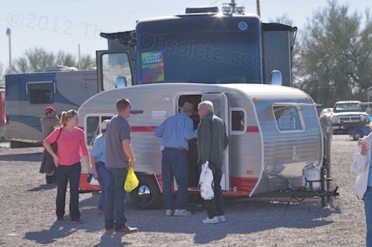 Surrounded by $200K motorhomes, this little cutie got a constant stream of action.