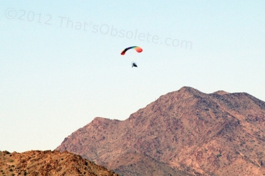 An ultralight making the climb to approach the nearby mountains.