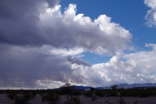 A look at the approaching sky. You can have rain from active clouds, yet plenty of bright blue sky, too.
