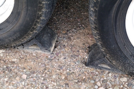 Better than nothing. Nails driven into the ground help keep the wheel chocks from moving.