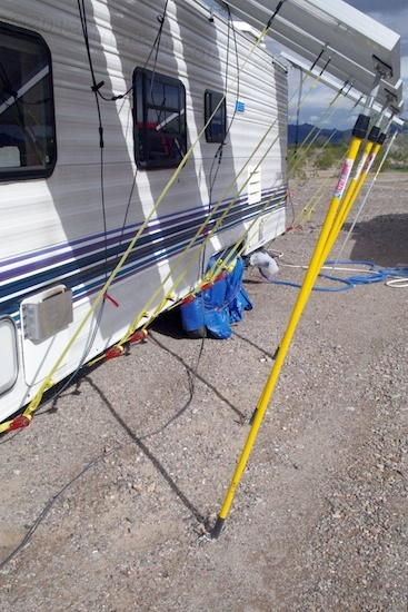 The poles really should go from panel to trailer instead of to ground, but there's no easy way to mount their bottom ends.