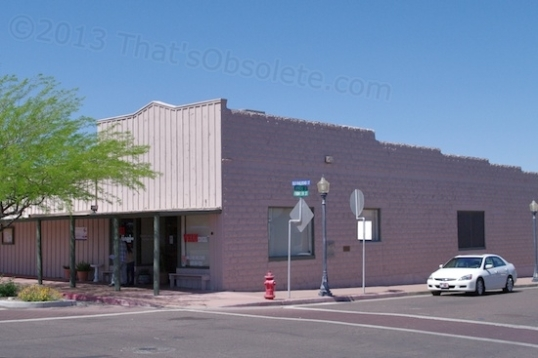 This 1918 building started as the Wickenburg Drug Company,, and then was Jones' Pharmacy. Then it was the Valley National Bank / Bank One from 1946-1995. It's made from molded cement blocks and is now a walk-in medical clinic.