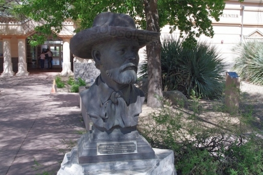 A bust of Henry Wickenburg, who discovered Vulture Mine in 1863. Born within the German Empire in 1819, he came to the U.S. in 1847 and headed for points west a few years later. He wandered all through Apache country looking for gold, and the problems started when he finally found it. The Vulture mine was easily the most productive in Arizona, but he didn't have the resources at the time to capitalize on its potential. Some say he sold his interests, while the most probable version is that he was swindled out of them. He then farmed and did well, but lost everything in a disastrous flood. His 160-acre ranch eventually became part of downtown Wickenburg. Challenges abounded, like Indian wars, bandits, flood, and drought. Generally regarded as gruff, quiet, fearless, honest and industrious, he won big, lost big, and finally died by his own hand in 1905.