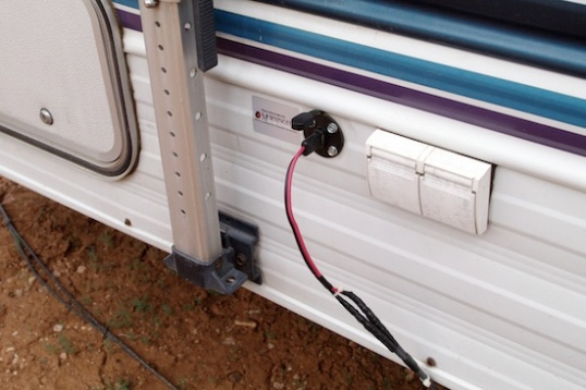 The solar power connector leading to the battery storage area under the bunkbed, to power the system for the CPAP device.