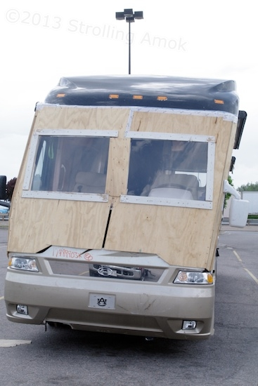 Just in case you're not sure, what's wrong with this picture of this uber-buck, high-end motorhome? Yes! It's bent and the front end is now plywood and plexi.
