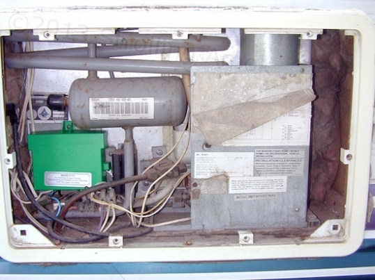 This is what the fridge looks like from the opening on the trailer exterior. You gots propane, alcohol, and electricity in one compartment. This is one reason why RVs have escape hatch windows.