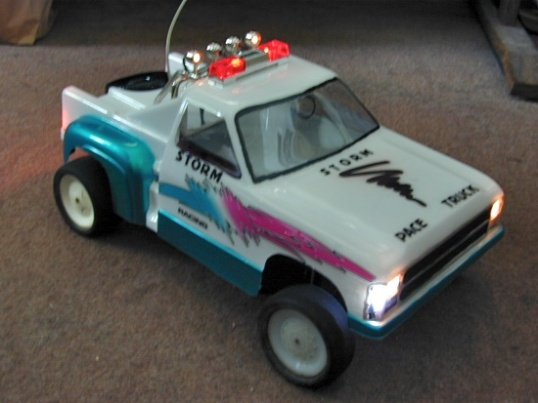 With lights and strobes flashing, this pace vehicle has a history - one that nobody gives a hoot about.