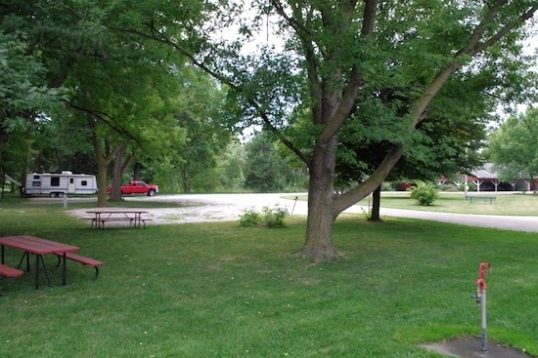 The Enterprise is way back there on the left, under some big shade trees.
