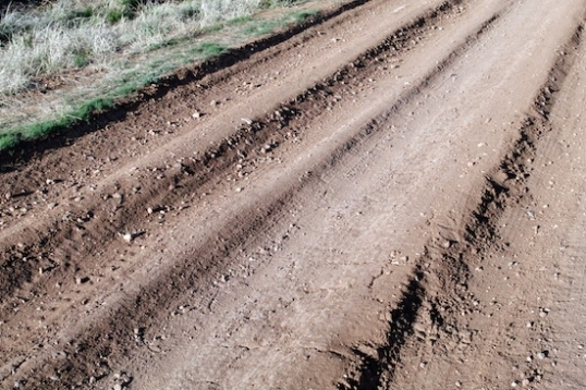 And when you see deep ruts like this, you know it'll be a good idea to stay on top of local weather forecasts and seasonal weather. Extended rain = deep mud. If you decide to stay put, how long can you camp before it dries out again?
