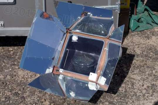 The solar oven in action: a pot allegedly full of beans & hamhocks.
