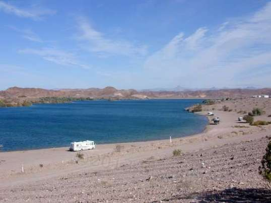 The reservoir's water level varies wildly depending on local irrigation use. It's replenished by controlled water flow all the way from Parker, about 110 miles north.
