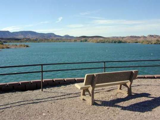 The day use area offers restrooms, picnic tables, benches, and restful views.
