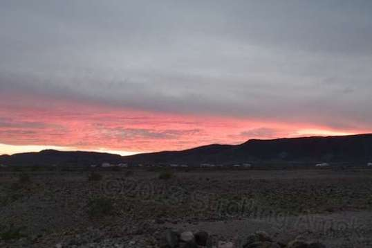 This sunset was unusual because of the roiling cloud. This red glow lasted just very few minutes.
