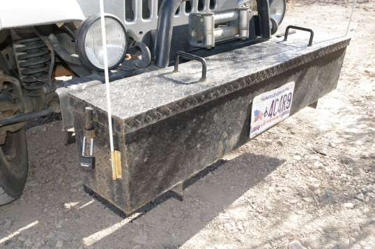 Charles made the toolbox. Its drop-down lid has a pin through ring that can be padlocked on each end.