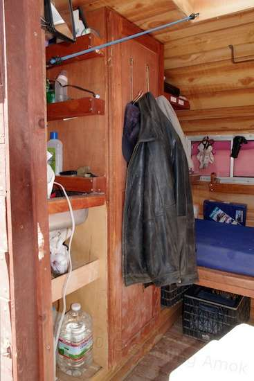 The opposite side of the trailer carries the clothes closet and wash-up area.