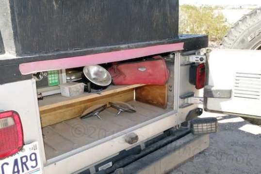 The tailgate makes this a good-sized lockable compartment.