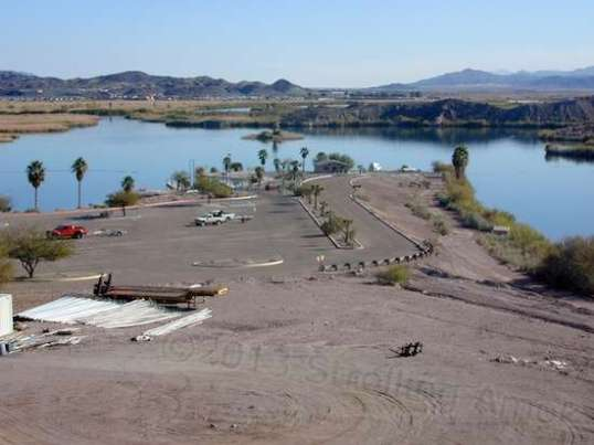 The boat ramp snakes down to right of center. Between its width and the size of the parking area, it's plain that it was designed for heavy usage.