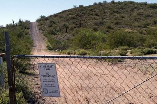 Many areas of State Trust land are leased out and locked up. This trail led to a huge water tank just over the hill.