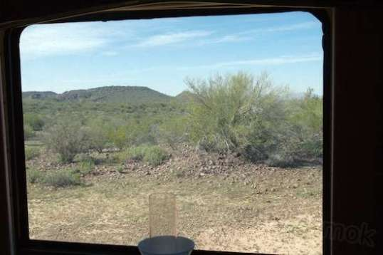 This is the view out my dining window. Ain't nothin' in sight except more Arizona.