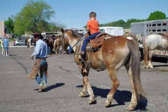 This kid looks like me in the saddle, only smaller. But it's fun and memorable!