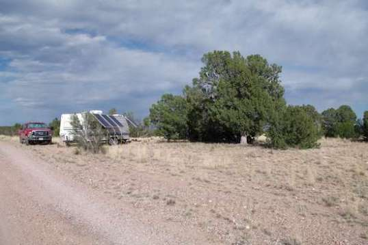 I had concerns about the truck's hot exhaust setting the ultra-dry tall grass on fire, but this site was the only bare spot for miles, and level, too! Those trees wound up not shading the solar panels due to the trailer's orientation and the sun's high arc.