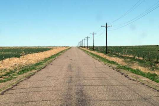 Roadside telephone poles are not a given out here. Many times, they simply criss-cross the distant landscape, if at all.