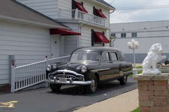 Part of its charm is a 1954-ish Packard hearse parked alongside and ready to serve. Until my time comes to go the way of all the earth, I'd still like a ride - in front - if it's all the same to you.