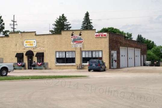 Businesses are scattered throughout the homes along the main drags. This is a photography studio and a car repair facility sharing the same building.
