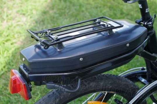 Stuffing a big battery directly underneath a rear rack compromises how that rack can be used.