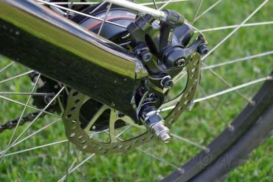 The rear brake. To avoid later squealing, the bike's manual advises a set routine of increasingly firm stops to seat the pads.