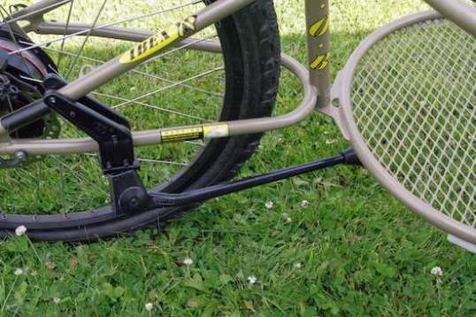 This Greenfield Stabilizer Kickstand is the bee's knees. It quickly bolts to the Ibex's fork and tucks out of the way.