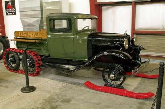 This kinky 1930 Ford Model A truck is fitted with skis and an extra axle for running tracks in the rear. The mail will get through!