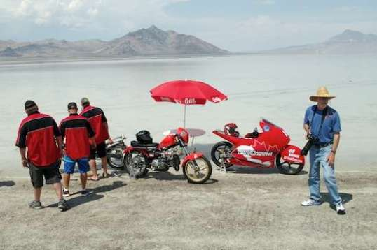 One team sets a table with umbrella out in the water and breaks the bikes out just because, well, what the heck. Why not?