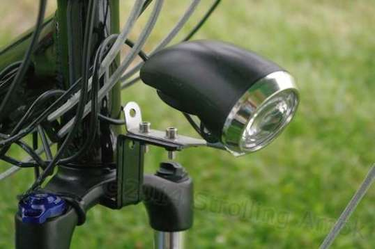This may not be the most elegant solution, but utilizing the existing fender bracket is the easiest way to get the headlamp back on after the fender is gone.
