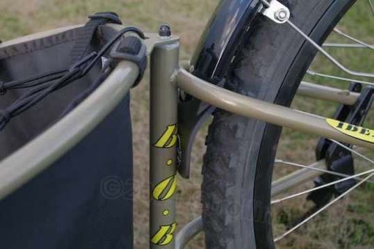 The Planet Bike's rear fender, when adjusted for Salt Mode, interferes with the trailer fork, which moves up and down against it. But fixing this without also fixing the trailer's rear tire salt-throwing problem won't cut it.