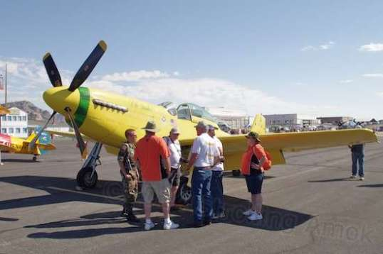 "On the ground, the P-51 ""Ole Yeller"" served as a meeting place."