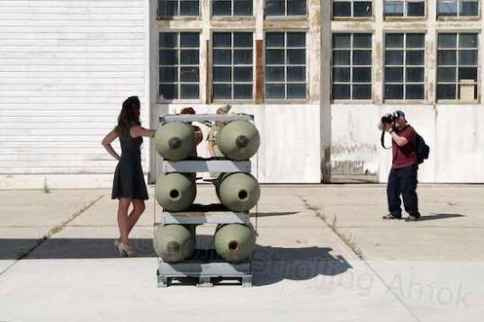 Three of those Friendly Ladies from Palookaville were serving cheesecake to an event photog in front of a WWII hangar.