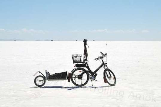 Yup, the Official Strolling Amok Videography Vehicle on the salt of Bonneville. As long as the salt is dry, the added fenders and flaps work quite well. Not perfect, but plenty good enough.
