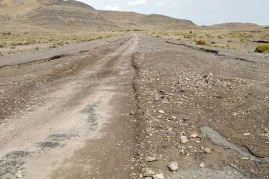 I'm standing on Leppy Pass Road looking uphill. It's a nice paved two-lane, and I suppose still is, under all the mud and rocks that charged down along it and across it during the rainstorm.