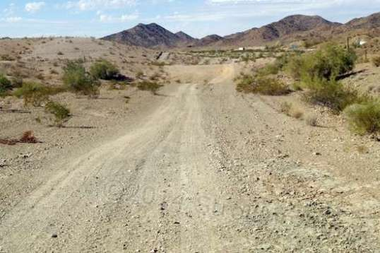 Starting out on this BLM trail looks pretty promising, since it's wide and smooth. The little white box ahead is a semi-trailer on I-10.