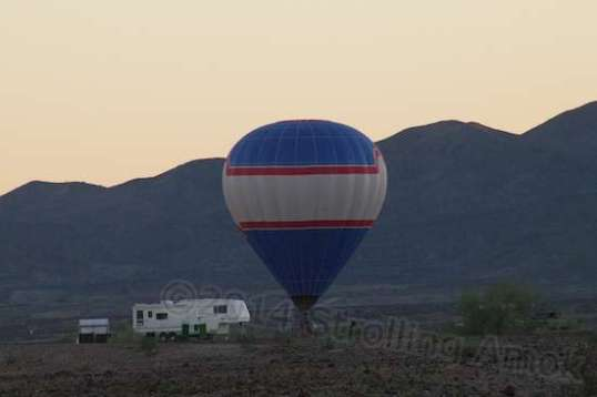 ...And finally contacted the ground, with a couple of other people running up to grab the basket at sunset.