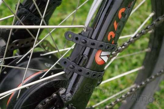 The fenders clamp on quickly, and hold much more securely than you'd guess by appearance.