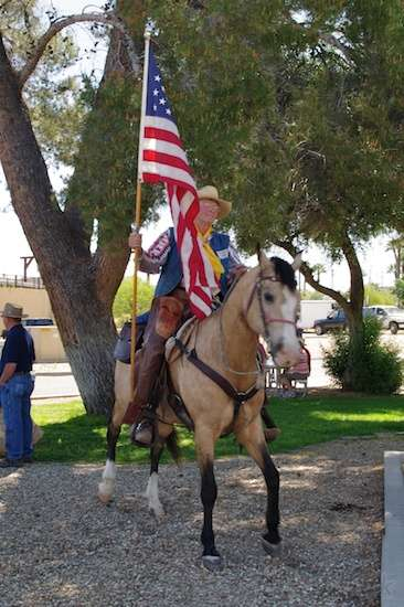 This horse was impatient to get going. Its rider felt honored to be the flag carrier this year.