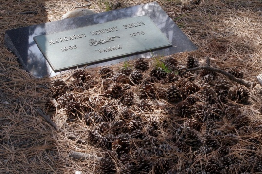 """Bamma's"" grave is coated end to end with pine cones, a sign that she is not forgotten."