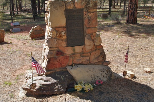 "This memorial stone says, ""In memory of those who gave their lives serving our country,"" listing a few area names from both World Wars."